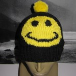 Smiley-bobble-Beanie-hat-knitting-pattern-by-madmonkeyknits1-150x150